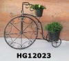 Antique metal bike with flower planter