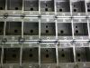 Sheet metal housings for light fitting track adaptors