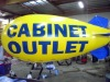 yellow advetising helium blimp blue empennages blue logo
