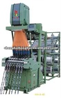 High speed shuttle less ribbon needle loom machine