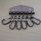 Six metal gunmetal key hooks with holder