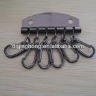 Six metal gunmetal key hooks with holder