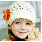 knitting wool baby cap with crochet flower