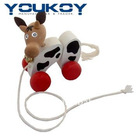 children pull along string cow wooden toys