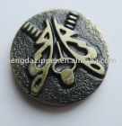 metal button with animal motif