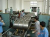 conveyor device/transmission device for steel drum machines or drum making machine