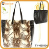 Oversized leather shopper bag with faux fur panel to the front
