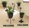 Standing metal planter and pots