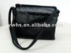 The black leather handbag