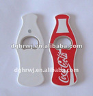 metal bottle shaped opener with coca cola logo