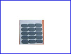 Adhesive grooved rubber pads