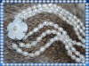 Triple strand pearl necklace with MOP clasp