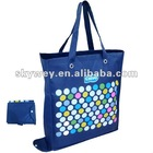 Colorful dots blue folded shopping bag
