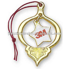 Brass holiday ornament with gold chain hanger