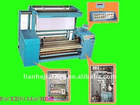 Fluffy fabric checking and packing machine