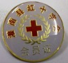 Gold-plated badge