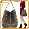 Trendy leather handbags studs and eyelets decoration