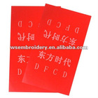 Red color white letters hang tag for garment