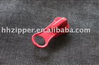plastic slider with thumb puller