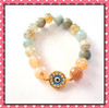faceted agate beads with gold evil eye charm bracelet