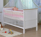 New Zealand pine cot bed