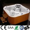 luxurious outdoor whirlpool spa with 2 loungers
