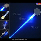 Clear Round plastic cocktail stirrer in blue light