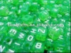dice beads/green letter