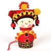 Red Chinese lovely minority hanging doll with a yellow little bal on head