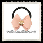 pretty peach bow with golden button
