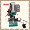 Pneumatic fridge magnet making machine