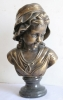 bronze bust statue.