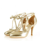 Gold color shinning high heel shoes