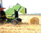 mini round balers picking meterials into cylinder shape