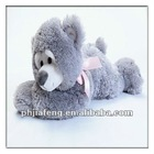 Grey lying plush bear