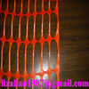 Orange-red plastic safety fence