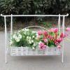 wrought iron swing flower rack