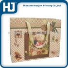 Shopping paper bag for women with ribbon