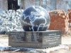 outdoor fountain with rolling globe