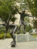 Bronze young person & skateboarding statue