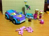 interested toy car with litter girl and other toys