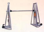 Itegrated reel stand with disc tension brake