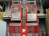 General hoist with twin cage material hoist