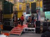 red plywood stage and light truss
