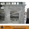 white marble fireplace with statue carved