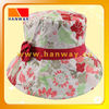 all-over flower print fabric fashion bush hat with red band and hand made flower trim