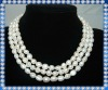 three strand pearl necklace with fancy clasp