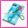 green eyelash curler