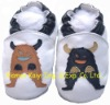 little kid shoes with cow picture