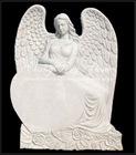 White marble angel tombstone